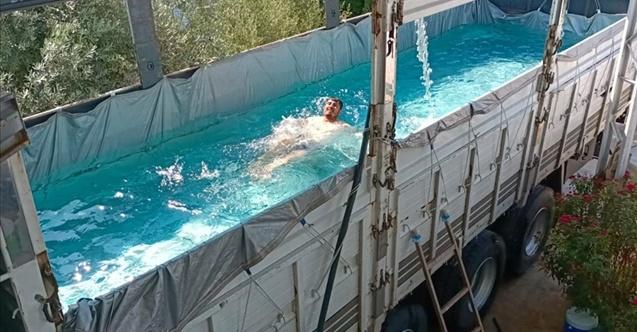 Sıcaktan bunalan çiftçi kamyonunu havuza çevirdi