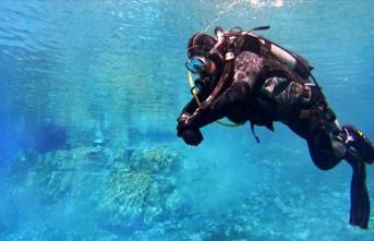 Vali ve dalgıçlar 'doğal akvaryum'u temizledi